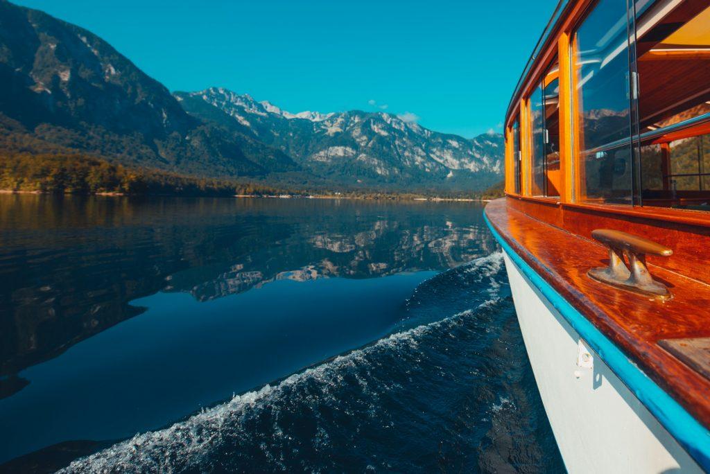 Boat sailing on lake Bohinj