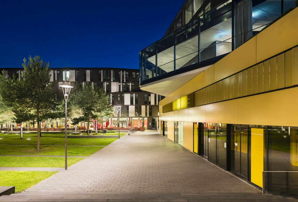 Modern City Buildings In Aachen, Germany At Night